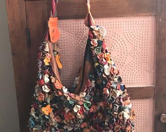 Vintage bohemian leather flower purse.