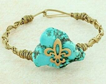 Fleur de Lis Turquoise Stone gold tone bracelet