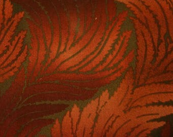 """Rust and burgundy """"Serenity""""line of fabric."""