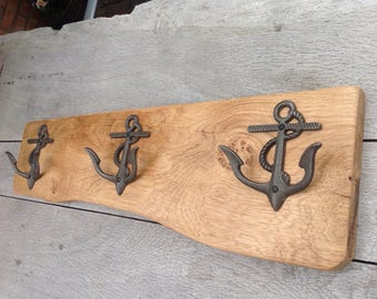 Double anchor cast iron hooks set on an oak back