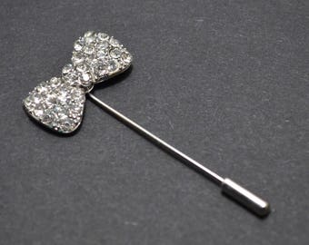 Silver bow brooch