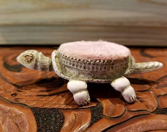 Articulated metal turtle pin cushion