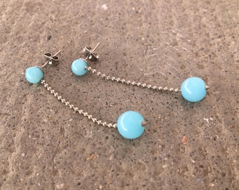 Earrings with light blue glass beads