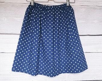 Skirt has polka dots, metallo has white polka dots, Navy blue cotton.