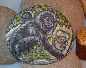 The monkey, animal guide, horoscope Maya, painted on rock