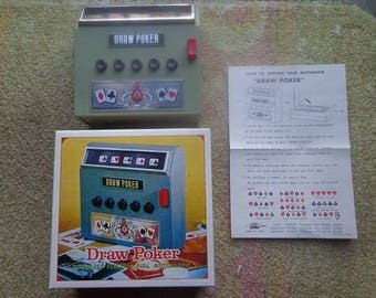 Battery operated draw poker card type game from 1971,unused in the box,works fine