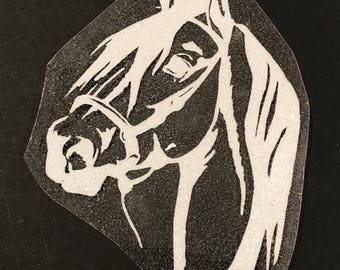 Fusible horse head motif