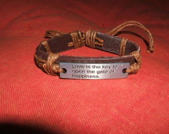 bracelet brown leather surrounded by a hemp rope, metal plate holder