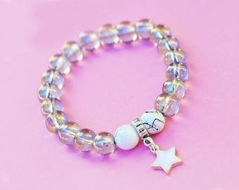Bracelet charm with iridescent grey glass beads