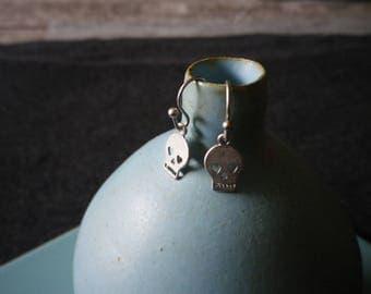 Stud Earrings in Silver (rhodium) plated skulls