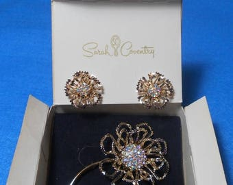 "SALE SALE! 1969 Boxed Sarah Coventry Gold Tone Aurora Borealis ""Allusion"" Flower Brooch & Clip On Earrings Set"