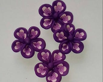 X 2 purple/white 24mm flower beads