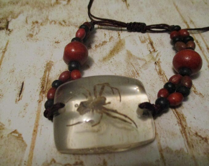 Spider in Clear Lucite Bracelet Wood Beads Slipknot Brown Yellow Pink