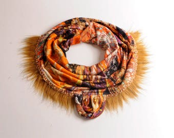orange snood cowl worked as a necklace