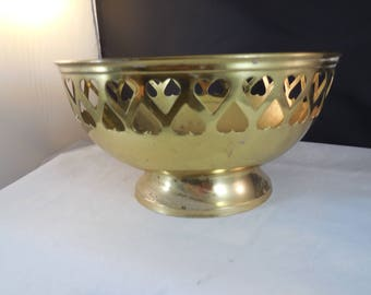 Vintage brass bowl with heart shapes taken out around the edge.