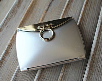 Silver. Compact. Mirror.