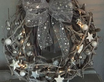 Light up wreath in silvers snd greys with stars, baubles and luxury bow.