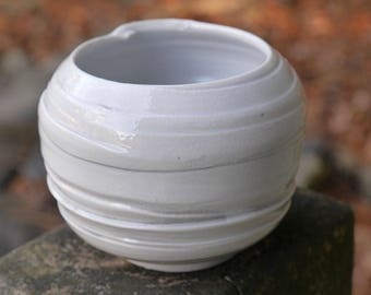Salt fired porcelain white tea bowl. Handthrown pottery with interesting texture.