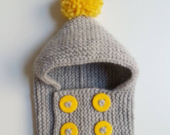 Hat(Cap) woolen hand-knitted baby from 0 to 2 years old intoxicates(tints) with yellow buttons and pompom