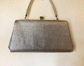 Metallic silver handbag/clutch