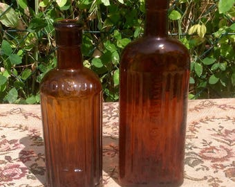 Two Large Amber Glass Poison Bottles. 1900's.