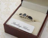 A very fine hand made 925 marked solid silver vintage jewelry dress ring set with three sparkly amethyst colour faceted stones
