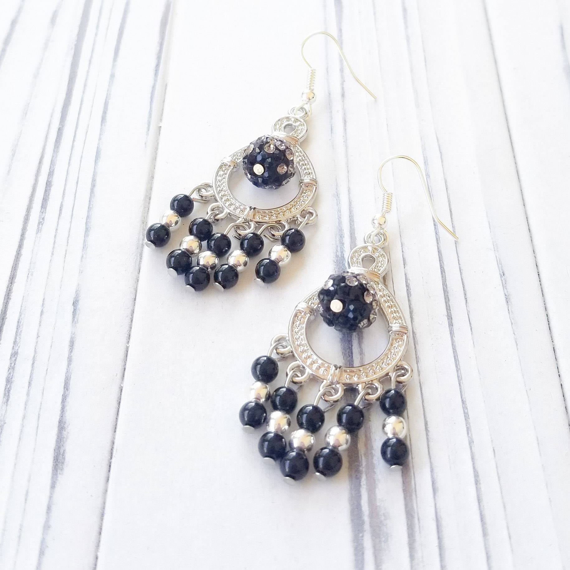 Black sparkle dangle chandelier earrings with a crystal studded bead arubaitofo Choice Image