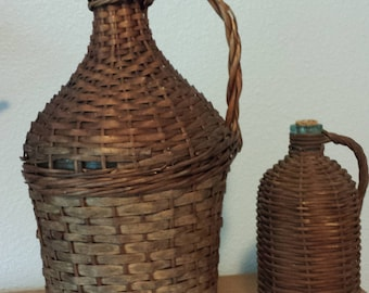 Pair of French antique demijohn wicker wrapped bottles