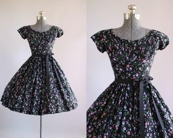 Vintage 1950s Dress / 50s Cotton Dress / Jerry Gilden Black and Purple Floral Dress w/ Ribbon Waist Tie S