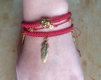 Bracelet with feathers, flowers and Buddha