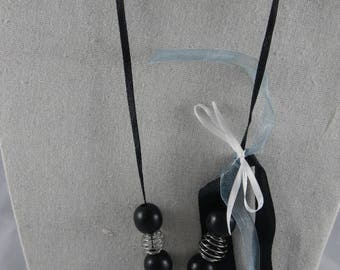 Black and silver necklace and silver pendant