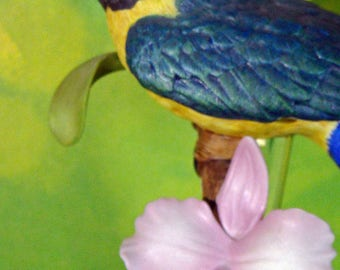 Stunning Franklin Mint Blue and Gold Macaw Ceramic Figurine from the Birds Of Paradise collection