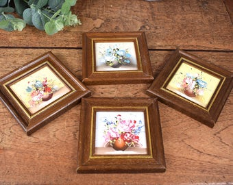 four original small oil paintings of flowers in square stained wood frames