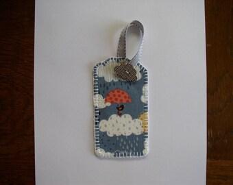the umbrella fabric bird bookmark and its cloud