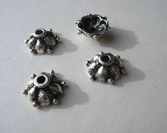 Set of 4 antique silver caps