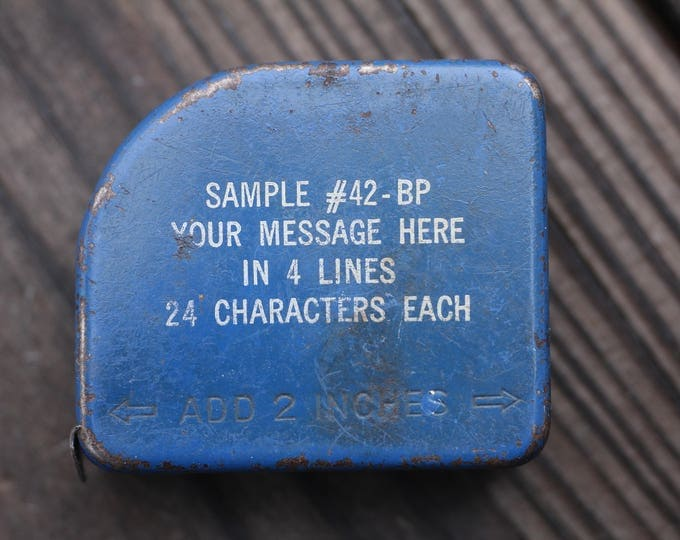 Vintage advertising sample tape measure made in West Germany