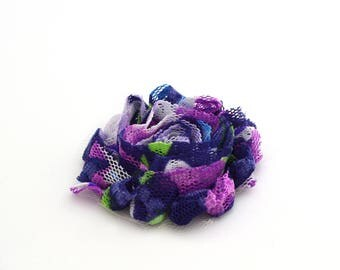 Frayed fabric blue color, purple flower