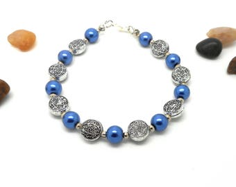 Silver bracelet blue beads and Silver flower