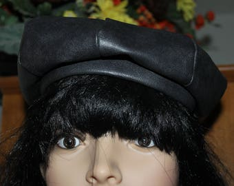 NICE CAP or Hat, Faux Leather, Inside is Silky Like, It is Dark Brown, It does Not Have a Size on it But it Fits my Mannequin perfect