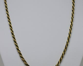 Lovely gold and black tone rope chain necklace
