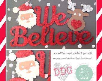 We Believe Christmas Plaque with Santa and Rudolph by Duck Duck Goose