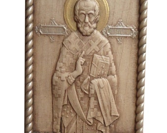 Wooden carved orthodox icon of St. Nicholas, made of maple, technique of carving wood, a gift to family and friends