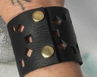 Perforated leather cuff.