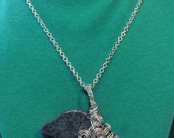 Grey marble dolphin on a silver plated chain and clasp.