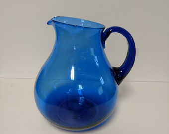Round Blue Glass Pitcher Pour Spout and Handle