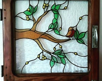 Old wood window with tiffany glass redbreast