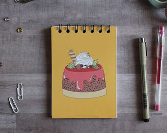 NOTEPAD. A6 Cute Cake Spiral Notepad. Soft 300 gsm Card Cover. 120 blank pages. Matte lamination pleasant to the touch.