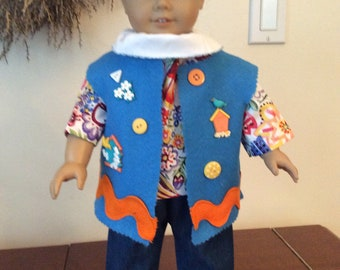 Turquoise Decorative Vest, Multi Colored Top and Blue Jeans