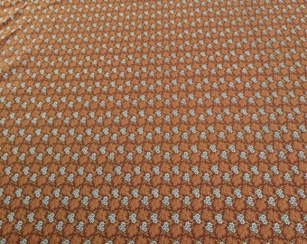 Molly B's 1800's-White Flowers on Brown Cotton Fabric from Marcus Fabrics