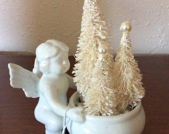 White ceramic cherub-white bottle brush trees-glitter-pearls-Christmas-Christmas in July-holiday-seasonal-angel-winter